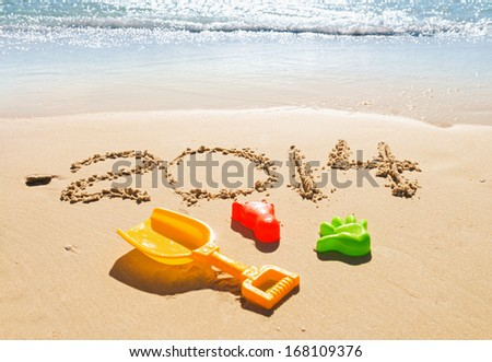 digits 2014 and toys on the sand seashore - concept of new year and vacation  - stock photo