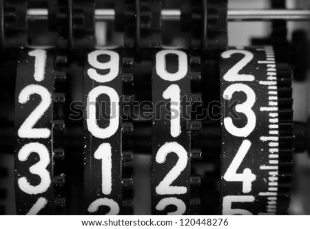 digits of a mechanical counter with the coming year 2013 - stock photo