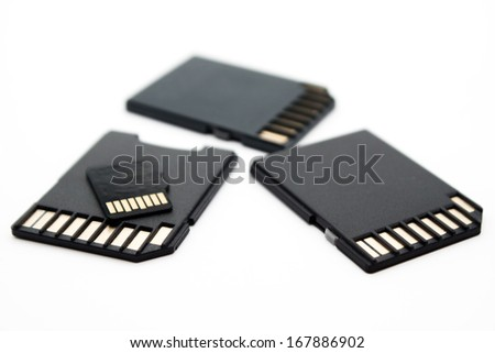 Diifferent size memory cards on white background - stock photo