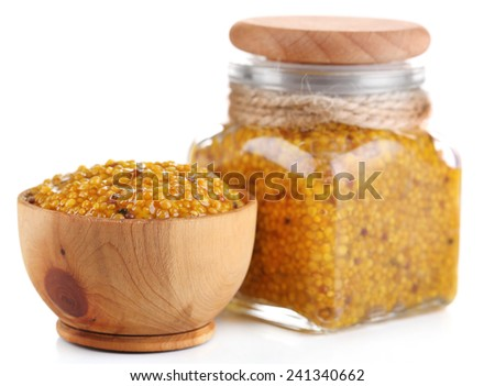 Dijon Mustard in glass jar and bowl isolated on white - stock photo