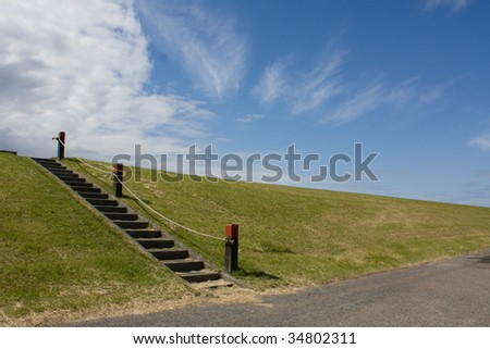dike and stairs - stock photo
