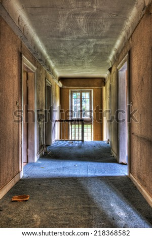 Dilapidated corridor in an abandoned house, HDR - stock photo