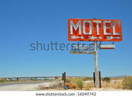 Dilapidated Motel Sign off of I-40 - stock photo