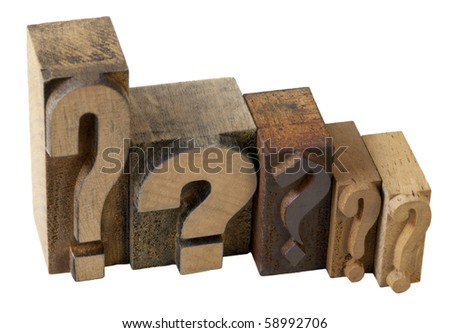 dilemma concept - 5 questions marks in vintage wooden letterpress printing blocks, isolated on white - stock photo