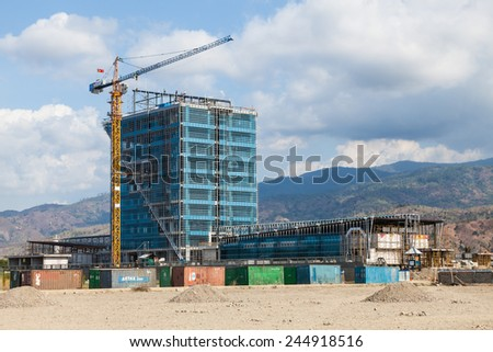 DILI, TIMOR LESTE - OCTOBER 25, 2013: New construction building in Dili - capital of East Timor. Coutry is rapidly recovering after United Nations ended its peacekeeping mission on December 31, 2012. - stock photo