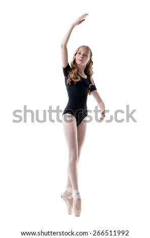 Diligent little ballerina, isolated on white - stock photo
