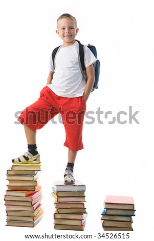 Diligent preschooler standing on the top of book stairs - stock photo