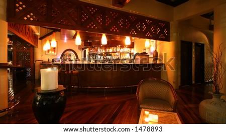 Dim lake-side bar at a Kuala Lumpur resort hotel - stock photo