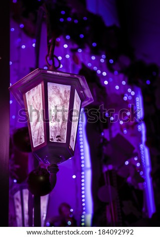 Dim light of a retro style street lamp in the violet night
