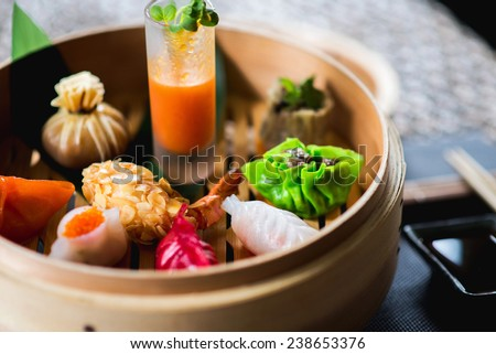 Dimsum Hagao in chinese bamboo basket. Gyoza on a wooden table in a restaurant - stock photo
