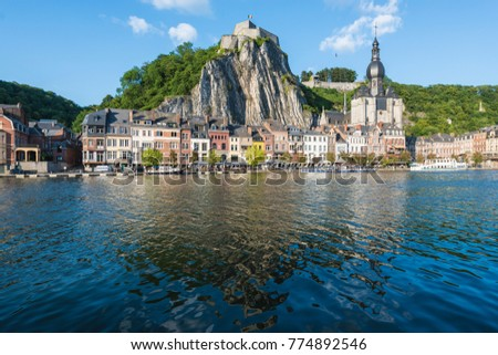 DINANT, BELGIUM JUNE 15, 2014: The Collegiate Church of Notre-Dame is the most important landmark of Dinant, located in the Waloon region, Belgium