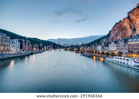 DINANT, BELGIUM â?? JUNE 15, 2014: The Meuse River passing through the town of Dinant, located in the Walloon, Belgium. - stock photo