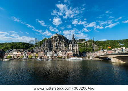 DINANT, BELGIUM  JUNE 15, 2014: The Meuse River passing through the town of Dinant, located in the Walloon, Belgium.