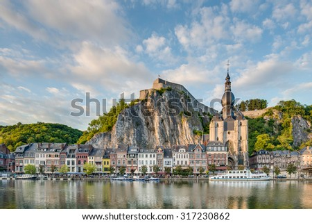 DINANT, BELGIUM - JUNE 15, 2014: The Meuse River passing through the town of Dinant, located in the Walloon, Belgium. - stock photo