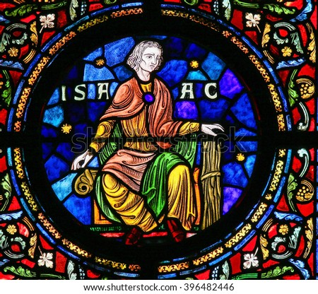 DINANT, BELGIUM - OCTOBER 16, 2011: Stained glass depicting Isaac, son of Abraham, one the Hebrew patriarchs, in the Notre Dame church of Dinant, Belgium - stock photo