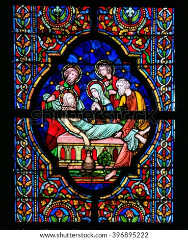 DINANT, BELGIUM - OCTOBER 16, 2011 Stained glass window depicting Jesus, wrapped in linen cloth, laid in His tomb, in the Notre Dame church in Dinant, Belgium - stock photo
