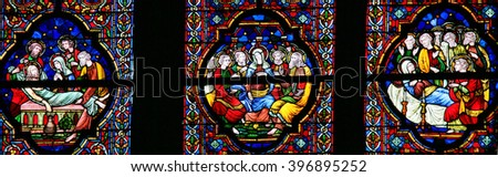 DINANT, BELGIUM - OCTOBER 16, 2011 Stained glass window depicting the burial of Jesus, Pentecost and the burial of Mother Mary, in the Notre Dame church in Dinant, Belgium - stock photo