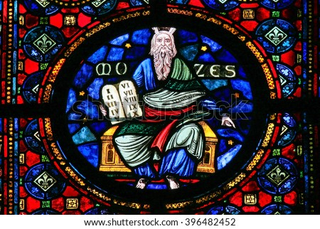 DINANT, BELGIUM - OCTOBER 16, 2011: Stained Glass window of Moses and the Stone Tablets with the Ten Commandments in the Church of Dinant, Belgium. - stock photo