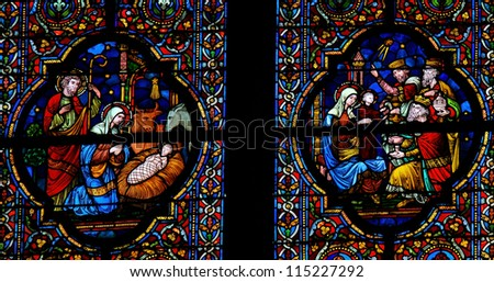 DINANT - OCTOBER 19: Stained glass window depicting Nativity Scene on Christmas and the Visit of the Three Magi in the cathedral of Dinant, Belgium, on October 19, 2011. - stock photo