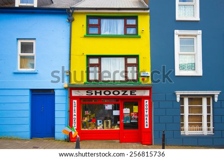 DINGLE, IRELAND - MARCH 29, 2013: View of charming colorful storefront along the streets of Dingle Ireland.  - stock photo