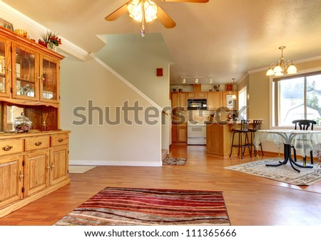 Dining  and living room and large area near kitchen home interior. - stock photo