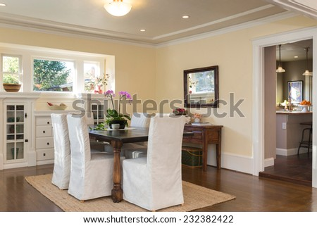 Dining area in villa with adjacent kitchen. - stock photo