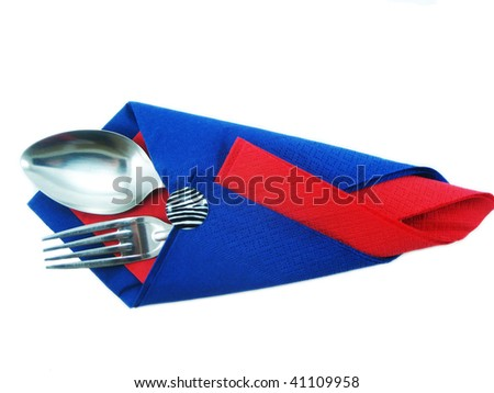 Dining facilities, plug and spoon in a red and dark blue napkin