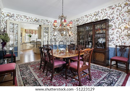 Dining room in luxury home with floral wallpaper