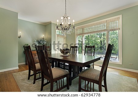 Dining room in luxury home with green walls - stock photo