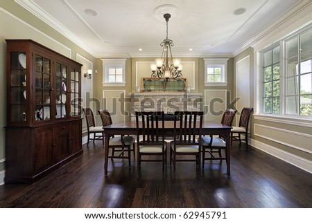 Dining room in luxury home with stone fireplace - stock photo