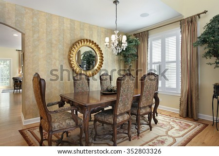 Dining room in luxury home with striped walls - stock photo