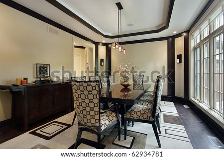 Dining room in luxury home with tray ceiling - stock photo