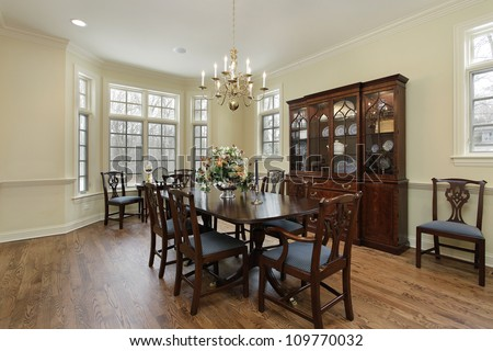 Dining room in suburban home with cream colored walls - stock photo
