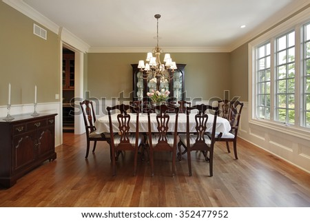 Dining room in suburban home with gold walls - stock photo