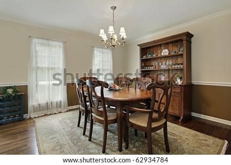Dining room in suburban home with oak wood table - stock photo