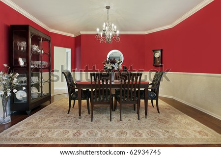 Dining room in suburban home with red walls - stock photo