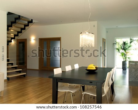 Dining room, staircase and corridor of modern house - stock photo