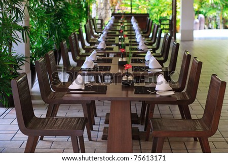 Dining room table with flower decoration - stock photo