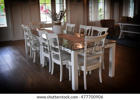 Dining room with a white wooden table to seat ten