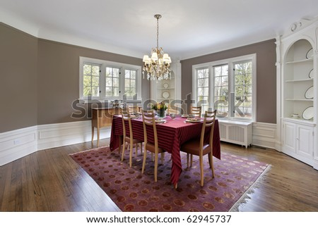 Dining room with built-in white wood cabinetry - stock photo