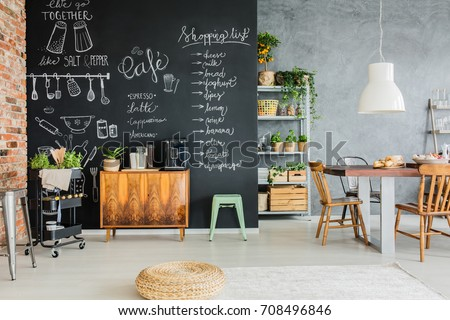 Dining Room With Chalkboard Wall, Wooden Chest And Kitchen Cart