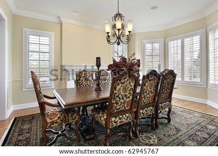 Dining room with fireplace and cream colored walls - stock photo