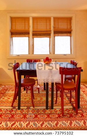 Dining room with folk design, warm yellow and red colors. Old craftsman style home in Seattle.
