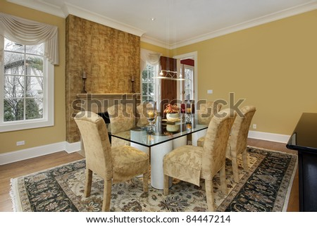 Dining room with gold walls and fireplace - stock photo