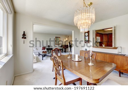 Dining room with rustic table set decorated with candles. - stock photo