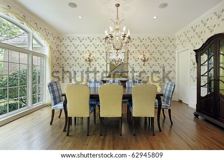 Dining room with yellow and blue plaid chairs - stock photo