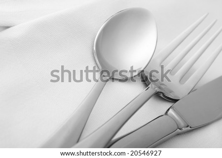 dining silverware with space for text - stock photo
