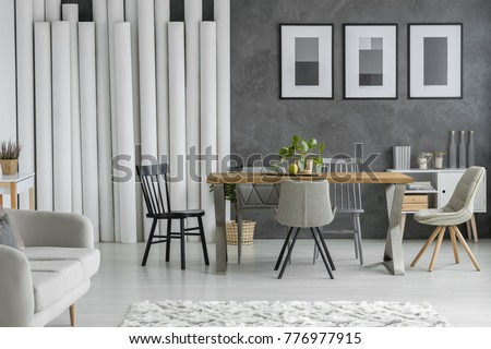 decorating furniture with paper. Dining Table And Chairs In Monochromatic Living Room With Paper Tubes Decoration Posters On Textured Decorating Furniture L