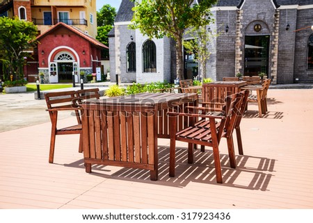 Dining table in front of the europe style buildings - stock photo