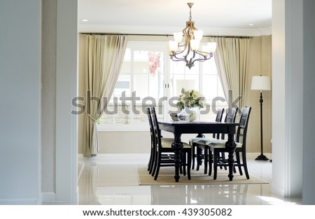 Dining table in luxury home with elegant table setting. - stock photo